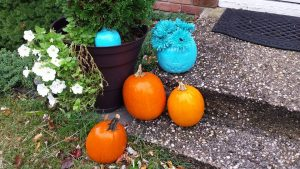 teal pumpkin on stoop